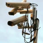 """Surveillance cameras"". Licensed under CC BY-SA 3.0 via Commons - https://commons.wikimedia.org/wiki/File:Surveillance_cameras.jpg#/media/File:Surveillance_cameras.jpg"